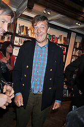 STEPHEN FRY at a party to celebrate the publication of 'A Matter of Life and Death' by Ronni Ancona and Alistair McGowan held at Daunt Books, 83 Marylebone High Street, London on 8th October 2009.