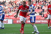 Middlesbrough forward Britt Assombalonga (9) is closely marked by Queens Park Rangers defender Jake Bidwell (3) before a corner is taken during the EFL Sky Bet Championship match between Middlesbrough and Queens Park Rangers at the Riverside Stadium, Middlesbrough, England on 23 February 2019.