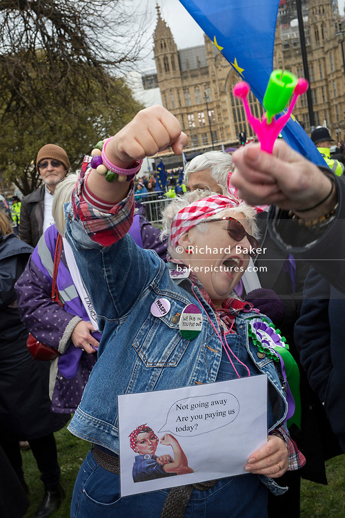Women from the Essex branch of the WASPI (Women's Action Against State Pension Injustice) protest on College Greeen in Westminster, the morning after another of Prime Minister Theresa May's Brexit deal votes failed again in Parliament, on 13th March 2019, in London, England.