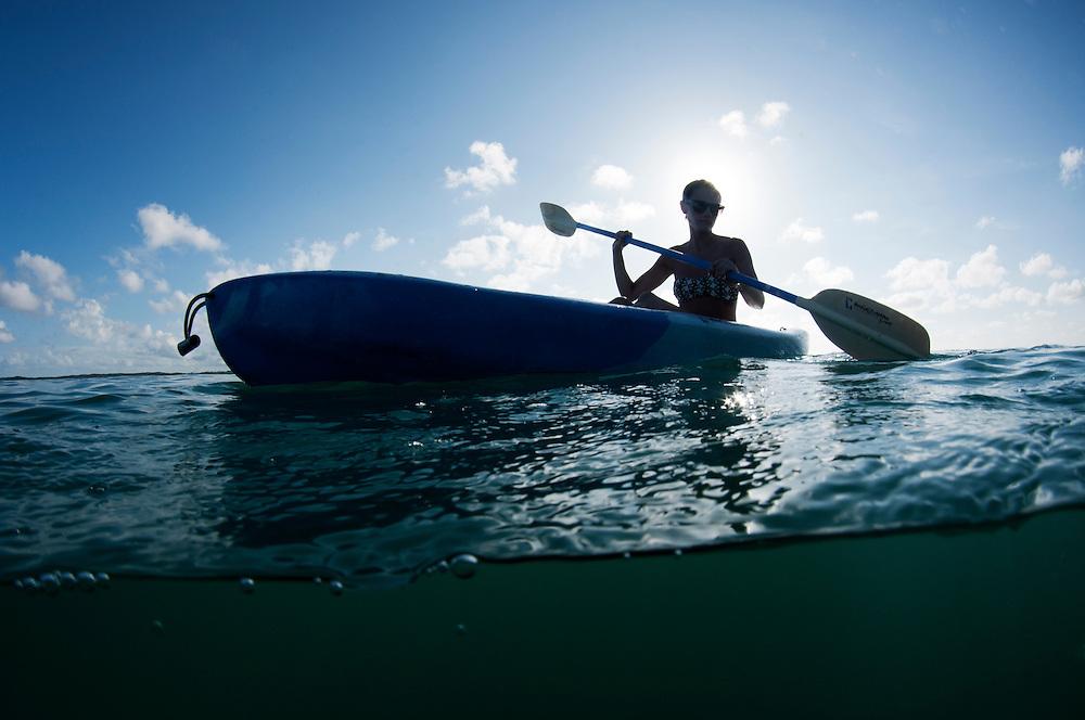 Female kayaking on the ocean
