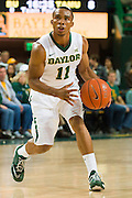 WACO, TX - DECEMBER 9: Lester Medford #11 of the Baylor Bears brings the ball up court against the Texas A&M Aggies on December 9, 2014 at the Ferrell Center in Waco, Texas.  (Photo by Cooper Neill/Getty Images) *** Local Caption *** Lester Medford