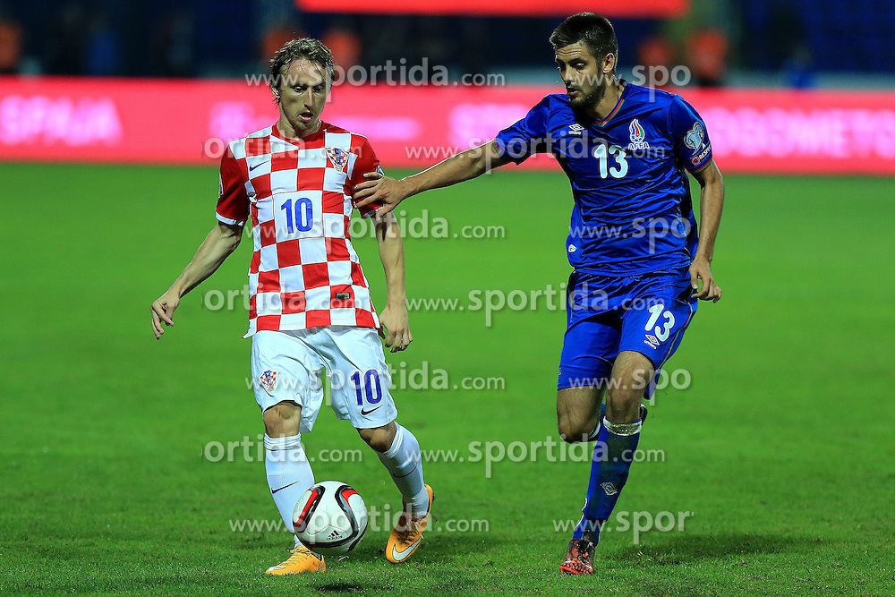 13.10.2014, Stadion Gradski vrt, Osijek, CRO, UEFA Euro Qualifikation, Kroatien vs Aserbaidschan, Gruppe H, im Bild Luka Modric, Dmitri Nazarov // during the UEFA EURO 2016 Qualifier group H match between Croatia and Azerbaijan at the Stadion Gradski vrt in Osijek, Croatia on 2014/10/13. EXPA Pictures &copy; 2014, PhotoCredit: EXPA/ Pixsell/ Davor Javorovic<br /> <br /> *****ATTENTION - for AUT, SLO, SUI, SWE, ITA, FRA only*****