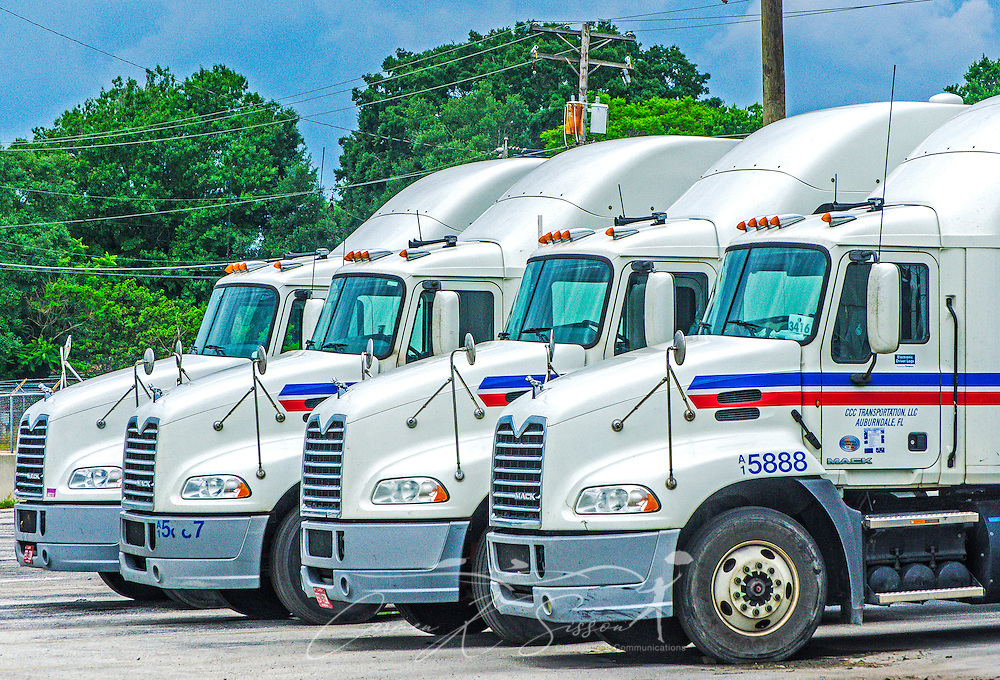 Mack Trucks are pictured outside the headquarters of Comcar Industries, April 16, 2015, in Auburndale, Fla. Approximately 80 percent of the 3,000-truck fleet is comprised of Macks. (Photo by Carmen K. Sisson/Cloudybright)