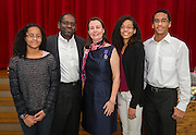 Claire Frazier, center, poses for a photograph with her family after being awarded the Chevalier dans Ordre des Palmes Academiques by France Cultural Attache Sylvie Christophe at Kolter Elementary School, November 20, 2013.