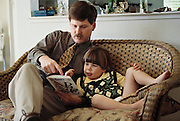 Usa.mw2.21.xs..High School teacher Craig Caven reads Dr. Suess with his son Ryan before leaving for a family Easter picnic. {{Craig Caven, 38, and Regan Ronayne, 42, and their two children, Andrea, 5, and Ryan 3, live in a multi-cultural bedroom community called American Canyon, California, about one hour north of San Francisco.}}.