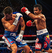 Manny Pacquiao of the Philippines (R) fights Chris Algieri of United States during their World Welterweight Championship bout at the Cotai Arena on November 23, 2014 in Macau, China. AFP PHOTO / XAUME OLLEROS