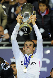 Real Madrid's Gareth Bale lifts the Uefa Super Cup - Photo mandatory by-line: Joe Meredith/JMP - Mobile: 07966 386802 12/08/2014 - SPORT - FOOTBALL - Cardiff - Cardiff City Stadium - Real Madrid v Sevilla - UEFA Super Cup