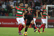 Maritimo´s player Dirceu (L ) fights for the ball with Benfica's player Salvio   (R ) during Portuguese First League football match C.S. Maritimo vs S.L. Benfica held at Barreiros Stadium, Funchal, Portugal, 01 December, 2016.