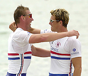 2002 World Rowing Championships - Seville - SPAIN.  21/09/2002.Matt Pinsent, left and James Cracknell congratulate each other, after stepping out of the boat, as the 2002 World champions in th men's pair, at  the World Rowing Championship,  held on the the Rio Guadalquiver course. [Mandatory Credit: Peter SPURRIER/Intersport Images]<br /> <br /> 20020921 World Rowing Championships Seville, SPAIN