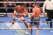 Tony Bellew throws a punch at David Haye and David Haye goes down in fifth round at the O2 Arena, London, United Kingdom on 5 May 2018. Picture by Phil Duncan.