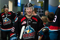 KELOWNA, CANADA - OCTOBER 23: Michael Farren #16 of the Kelowna Rockets fist bumps fans on his way to the dressing room after the win against the Swift Current Broncos on October 23, 2018 at Prospera Place in Kelowna, British Columbia, Canada.  (Photo by Marissa Baecker/Shoot the Breeze)