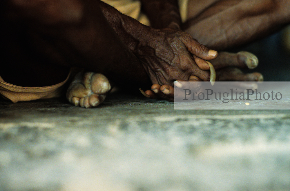 Kenyakumary, India 1994. Portrait of a Sadhu sitting on the floor