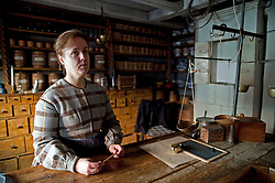 Shopkeeper in traditional costume at Skansen open air historical museum in Stockholm Sweden 2009