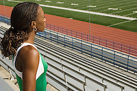Female track athlete looking over stadium