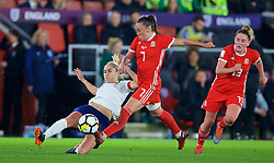SOUTHAMPTON, ENGLAND - Friday, April 6, 2018: Wales' Natasha Harding and England's captain Steph Houghton during the FIFA Women's World Cup 2019 Qualifying Round Group 1 match between England and Wales at St. Mary's Stadium. (Pic by David Rawcliffe/Propaganda)