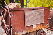 Ore cart and Interpretive plaque at the Rico silver mine, Rico, Colorado USA