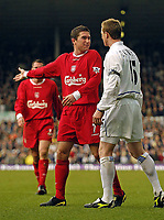 Photo. Jed Wee.<br /> Leeds United v Liverpool, FA Barclaycard Premiership, Elland Road, Liverpool. 29/02/2004.<br /> Liverpool's Harry Kewell (L) tries to explain his actions as Leeds' Steven Caldwell confronts him for playing on as Gary Kelly lay injured.