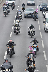 © Licensed to London News Pictures. 12/04/2019. London UK: Scores of bikers ride through east London to join up with other riders from all over the country at Westminster. The riders thought to number around 20,000 in total are showing support for soldier F, a 77 year old Army veteran who faces murder charges from the bloody Sunday shootings 47 years ago  , Photo credit: Steve Poston/LNP