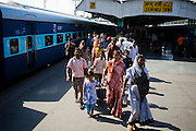 Passengers disembark the Himsagar Express 6317 at Jammu Tawi station after its four day journey from Kanyakumari on 6th July 2009.. .6318 / Himsagar Express, India's longest single train journey, spanning over 3720 kms, going from the mountains (Hima) to the seas (Sagar), from Jammu and Kashmir state in the Indian Himalayas to Kanyakumari, the southern-most tip of India..Photo by Suzanne Lee / for The National.