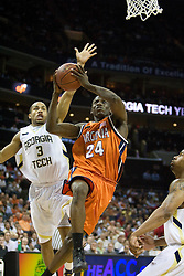 Virginia guard/forward Mamadi Diane (24) beats Georgia Tech guard Maurice Miller (3) to the basket.  The Virginia Cavaliers fell to the Georgia Tech Yellow Jackets 94-76  in the first round of the 2008 ACC Men's Basketball Tournament at the Charlotte Bobcats Arena in Charlotte, NC on March 13, 2008.