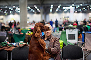 Portrait of a participant with his dog posing for a photograph at the Leipzig Trade Fair. Over 31,000 dogs from 73 nations will come together from 8-12 November 2017 in Leipzig for the biggest dog show in the world.