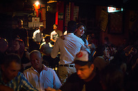 Medellin, Colombia- March 15, 2015: Patrons hit the dance floor at Son Havana, an intimate Cuban-themed salsa bar in the Laureles neighborhood. CREDIT: Chris Carmichael for The New York Times