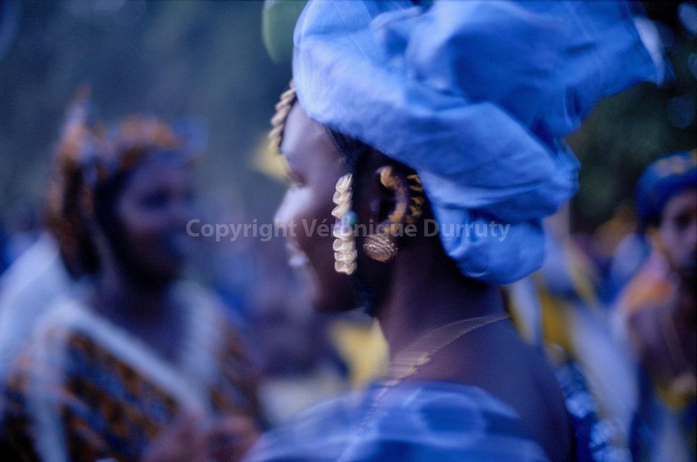 """Peul young woman dancing, DIAFARABE,MALI. Every year, in the small village of Diafarabe, the feast of the """"cows crossing"""" is one of the most important in the year and is in the UNESCO's world heritage.// JEUNE FEMME PEULE EN TRAIN DE DANSER, VILLAGE DE DIAFARABE, MALI chaque année la fête de la """"traversée des vaches"""" dans le petit village de Diafarabé sur les rives du fleuve Niger, donne lieu à l'une des plus importantes fêtes peules de l'année. Les femmes revêtent leurs plus beaux atours, vêtements et bijoux, et dansent une grande partie de la nuit. Cette fête est classée au patrimoine mondial de l'humanité UNESCO."""