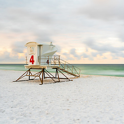 Pensacola Beach lifeguard tower four at the start of sunrise on Casino Beach. Pensacola Beach is on Santa Rosa Island in the Emerald Coast area of the Southeastern United States of America. Photo is high resolution. Copyright ⓒ 2018 Paul Velgos with All Rights Reserved.