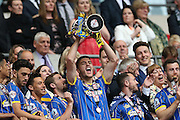 Ryan Sweeney lifting the trophy after winning 2-0 in the Sky Bet League 2 play off final match between AFC Wimbledon and Plymouth Argyle at Wembley Stadium, London, England on 30 May 2016.