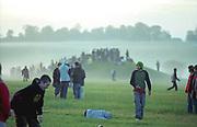 Summer Solstice faithful scattered around a misty field, UK 2005