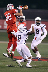 11 December 2015:  Anthony Warrum(82) elevates a bit to catch a ball and to stay away from Jarriel Jordan. NCAA FCS Quarter Final Football Playoff game between Richmond Spiders and Illinois State Redbirds at Hancock Stadium in Normal IL (Photo by Alan Look)