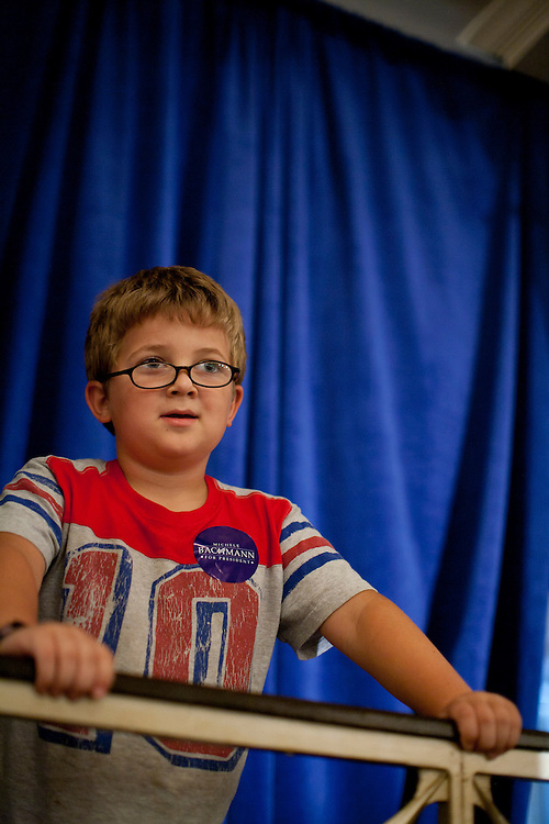 A boy listens to Republican presidential hopeful Michele Bachmann speak during a campaign stop on Sunday, July 24, 2011 in Davenport, IA.