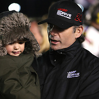NASCAR Sprint Cup driver Jeff Gordon (24) is seen with with his daughter Ella Sophia prior to the NASCAR Sprint Unlimited Race at Daytona International Speedway on Saturday, February 16, 2013 in Daytona Beach, Florida.  (AP Photo/Alex Menendez)