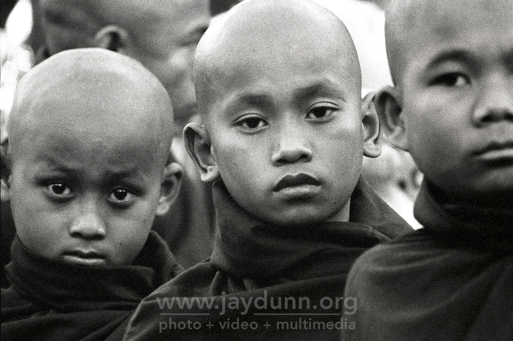 "BURMA (MYANMAR), Mandalay Division, Bagan, Myinkabar.2006. At dawn, young monks wait for Lu Ro Bi?s magical ""paya pwe,"" or temple festival, to begin. Some of the temples remaining on the Bagan plain have active constituents."