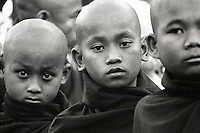 """BURMA (MYANMAR), Mandalay Division, Bagan, Myinkabar.2006. At dawn, young monks wait for Lu Ro Bi?s magical """"paya pwe,"""" or temple festival, to begin. Some of the temples remaining on the Bagan plain have active constituents."""