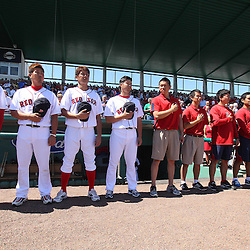 March 12, 2011; Fort Myers, FL, USA;  Boston Red Sox players (from left to right) Hideki Okajima, Daisuke Matsuzaka, Itsuki Shoda, and Junichi Tazawa along with team staff members stand during a moment of silence for quake and tsunami victims in Japan before a spring training exhibition game against the Florida Marlins at City of Palms Park. The Red Sox defeated the Marlins 9-2.  Mandatory Credit: Derick E. Hingle