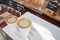 Disposable coffee cups on table