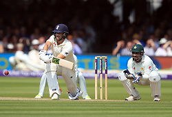 England's Dawid Malan hits out for four runs during day three of the First NatWest Test Series match at Lord's, London.