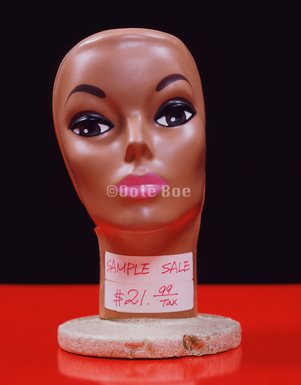 a female display head with price tag taped on its neck.