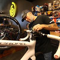 Adam Robison | BUY AT PHOTOS.DJOURNAL.COM<br /> Kurt Jones, bike mechanic at Core Outdoor, installs new cables on a customers bike.
