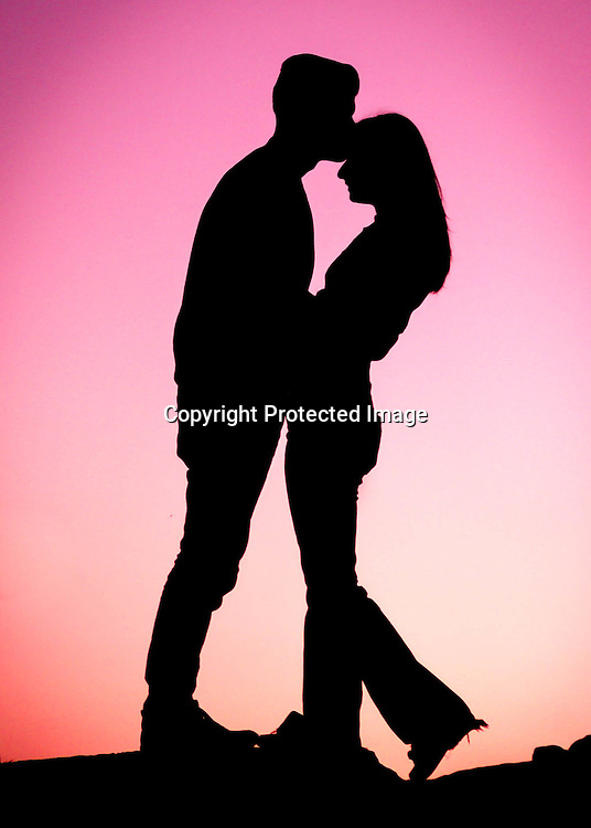 Couple in love against a pink background