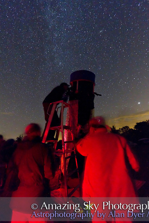 Observers using a large Dobsonian reflector telescope at the annual Starfest star party near Mt Forest, Ontario, August 2011. A single exposure of 30s at ISO 3200 with Canon 7D and 10-22mm lens at f/4.