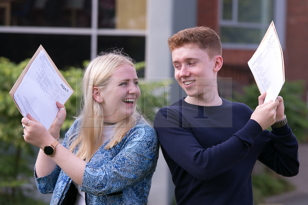 © Licensed to London News Pictures. 18/08/2016. Solihull School students receiving their A Level results earlier today. Pictured, Head girl Leticia Salmon who is off to Cambridge with Head boy Ben Northam who's off to Oxford. Photo credit: Dave Warren/LNP