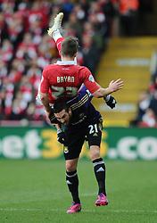Bristol City's Joe Bryan is fouled by West Ham's Morgan Amalfitano  - Photo mandatory by-line: Joe Meredith/JMP - Mobile: 07966 386802 - 25/01/2015 - SPORT - Football - Bristol - Ashton Gate - Bristol City v West Ham United - FA Cup Fourth Round