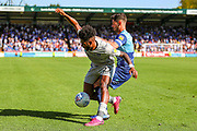 Portsmouth forward Ellis Harrison (22) fouled by Wycombe Wanderers defender Joe Jacobson (3) during the EFL Sky Bet League 1 match between Wycombe Wanderers and Portsmouth at Adams Park, High Wycombe, England on 21 September 2019.