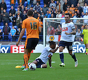 Neil Danns appeals for the foul during the Sky Bet Championship match between Bolton Wanderers and Wolverhampton Wanderers at the Macron Stadium, Bolton, England on 12 September 2015. Photo by Mark Pollitt.