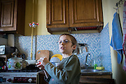 Yaroslav, 10, is playing with a small photo/video-recording drone while in the kitchen of the provisional home where he resides with his mother Olga, 36, as internally displaced persons. (IDPs) Yeroslav is taking part to the UNICEF-sponsored One Minute Junior project for internally displaced persons (IDPs), carried out by the local NGO 'Ukrainian Frontiers' in the city of Kharkiv, the country's second-largest, in the east. The conflict between Ukrainian army and Russia-backed separatists nearby, in the Donbass region, have left more than 10000 dead since April 2014, including over 1000 since the shaky Minsk II ceasefire came into effect in February 2015. The approximate number of people displaced by the conflict is 1.4 million as of August 2015. Yeroslav's mother, Olga, is also a participant to a different project of 'Ukrainian Frontiers', called 'Self-Employment', first as a beneficiary, and now as a paid hotline coordinator for people seeking jobs and formation courses.