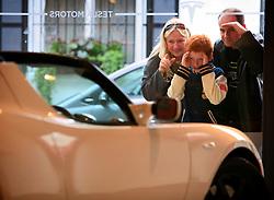 UK ENGLAND LONDON 1JUN10 - Customers admire the new Tesla Roadster Electric supercar on display at the Tesla showroom in Knightsbridge, Kensington, London.<br /> <br /> jre/Photo by Jiri Rezac<br /> <br /> © Jiri Rezac 2010