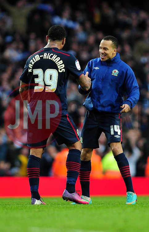 Blackburn Rovers' Colin Kazim-Richards and Blackburn Rovers' Marcus Olsson celebrate their win at the end of the game - Photo mandatory by-line: Dougie Allward/JMP - Tel: Mobile: 07966 386802 16/02/2013 - SPORT - FOOTBALL - Emirates Stadium - London -  Arsenal V Blackburn Rovers - FA Cup - Fifth Round