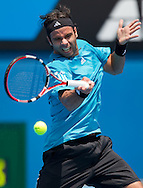 Fernando Gonzalez (CHI) [11]<br /> 2010 Australian Open Tennis<br /> Mens Singles<br /> First Round<br /> 18/01/10<br /> Fernando Gonzalez of Chillie plays a forhand<br /> &quot;Show Court 2&quot; Melbourne Park, Melbourne, Victoria, Australia<br /> Photo By Lucas Wroe